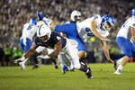 Penn State running back Journey Brown (4) tips a punt by Buffalo punter Evan Finegan (40) in the third quarter of an NCAA college football game in State College, Pa., on Saturday, Sept. 7, 2019. Finegan was injured on the play and carted off the field.(AP Photo/Barry Reeger)