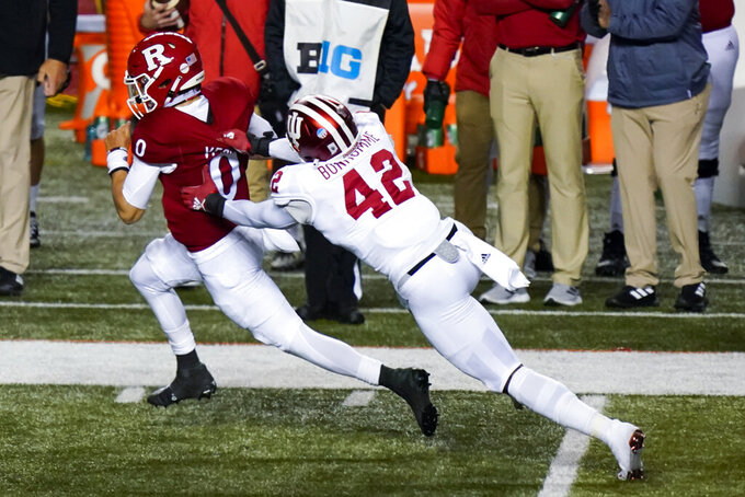Indiana linebacker D.K. Bonhomme (42) pursues Rutgers quarterback Noah Vedral (0) in the fourth quarter of an NCAA college football game, Saturday, Oct. 31, 2020, in Piscataway, N.J. (AP Photo/Corey Sipkin)