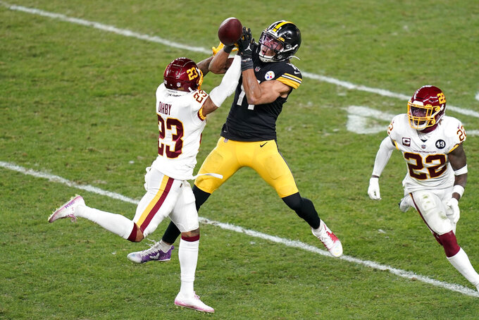 Washington Football Team cornerback Ronald Darby (23) breaks up a pass intended for Pittsburgh Steelers wide receiver Chase Claypool (11) during the second half of an NFL football game, Monday, Dec. 7, 2020, in Pittsburgh. (AP Photo/Keith Srakocic)