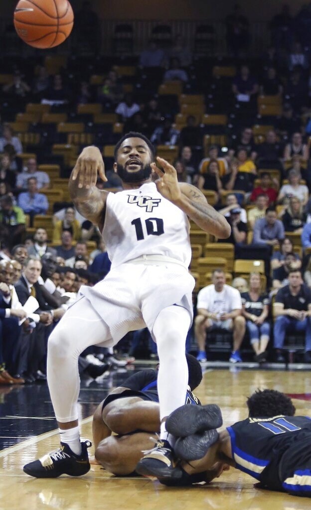 UCF guard Dayon Griffin (10) passes as he falls during an NCAA basketball game against Tulsa in Orlando, Fla., on Saturday, Jan. 19, 2019. (Stephen M. Dowell/Orlando Sentinel via AP)