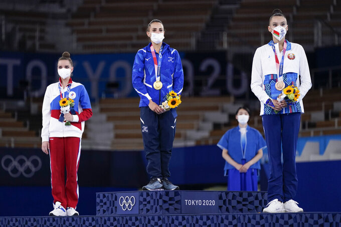From left, silver medalist Dina Averina, of Russian Olympic Committee, gold medalist Linoy Ashram, of Israel, and bronze medalist Alina Harnasko, of Belarus, stand on the podium after the rhythmic gymnastics individual all-around final at the 2020 Summer Olympics, Saturday, Aug. 7, 2021, in Tokyo, Japan. (AP Photo/Ashley Landis)