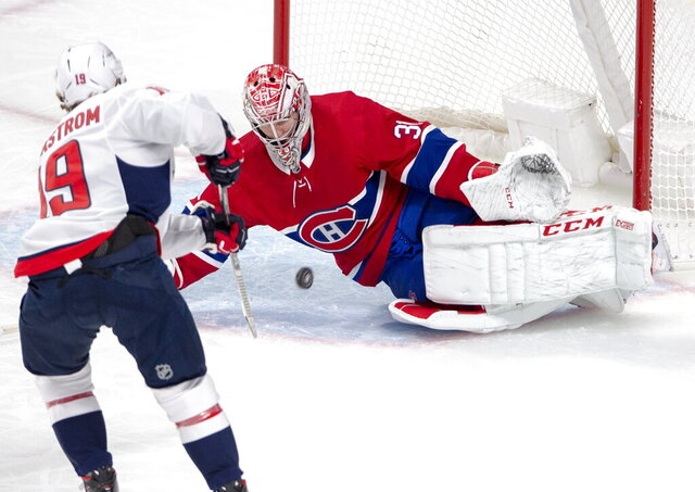 Montreal Canadiens goaltender Carey Price (31) makes the save on Washington Capitals centre Nicklas Backstrom (19) during first period NHL hockey action Monday, Jan. 27, 2020 in Montreal. (Ryan Remiorz/The Canadian Press via AP)