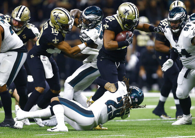 New Orleans Saints running back Mark Ingram (22) is hit by Philadelphia Eagles free safety Avonte Maddox (29) in the first half of an NFL divisional playoff football game in New Orleans, Sunday, Jan. 13, 2019. (AP Photo/Butch Dill)