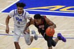 St. Francis' Ramiir Dixon-Conover (2) drives past Pittsburgh's Ithiel Horton (0) during the second half of an NCAA college basketball game, Wednesday, Nov. 25, 2020, in Pittsburgh. St. Francis won 80-70. (AP Photo/Keith Srakocic)