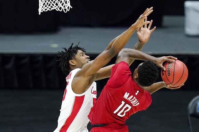 Rutgers' Montez Mathis (10) drives against Houston's Brison Gresham, left, during the first half of a college basketball game in the second round of the NCAA tournament at Lucas Oil Stadium in Indianapolis Sunday, March 21, 2021. (AP Photo/Mark Humphrey)
