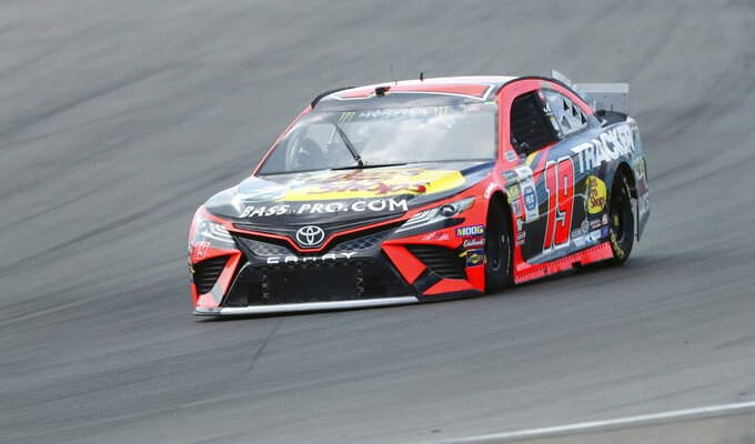 Martin Truex Jr. (19) heads into Turn 1 during practice for the NASCAR Cup Series auto race at Watkins Glen International, Saturday, Aug. 3, 2019, in Watkins Glen, N.Y. (AP Photo/John Munson)