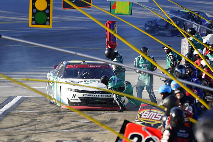 Justin Haley pits during a NASCAR Xfinity Series auto race at Talladega Superspeedway, Saturday, Oct. 3, 2020, in Talladega, Ala. (AP Photo/John Bazemore)
