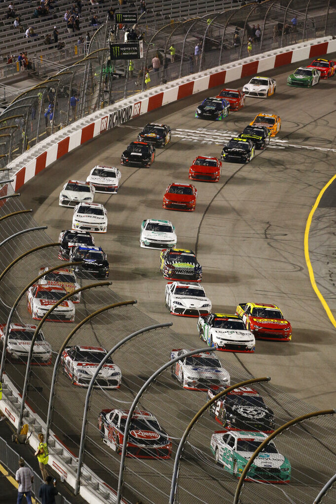 Austin Cindric (22) leads the field at the start of the NASCAR Xfinity Series auto race at Richmond Raceway in Richmond, Va., Friday, Sept. 20, 2019. (AP Photo/Steve Helber)