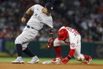 Los Angeles Angels' David Fletcher, right, steals second base as New York Yankees third baseman Rougned Odor puts on the late tag during the fourth inning of a baseball game in Anaheim, Calif., Tuesday, Aug. 31, 2021. (AP Photo/Alex Gallardo)