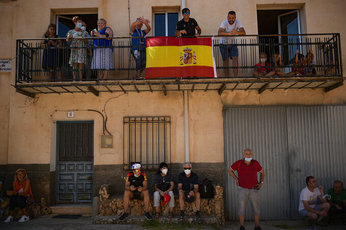 Fans of La Vuelta wait for the race during the fourth stage between Burgo de Osma and Molina de Aragon, 163,9 kilometers of La Vuelta cycling race, northern Spain, Tuesday, Aug. 17, 2021. (AP Photo/Alvaro Barrientos)