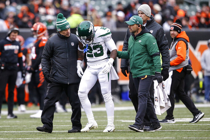 New York Jets cornerback Arthur Maulet (23) is helped off the field during the second half of an NFL football game against the Cincinnati Bengals, Sunday, Dec. 1, 2019, in Cincinnati. (AP Photo/Gary Landers)