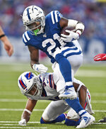 Buffalo Bills' Kevin Johnson, bottom, tackles Indianapolis Colts' Nyheim Hines during the first half of an NFL preseason football game, Thursday, Aug. 8, 2019, in Orchard Park, N.Y. (AP Photo/Adrian Kraus)