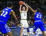 Notre Dame's Rex Pflueger (0) shoots over Hampton's Akim Mitchell (25) during an NCAA college basketball game in the first round of the NIT tournament, Tuesday, March 13, 2018, in South Bend, Ind.   (Michael Caterina/South Bend Tribune via AP)