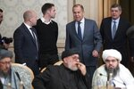 Russian Foreign Minister Sergey Lavrov, second right, arrives to attend a conference on Afghanistan bringing together representatives of the Afghan authorities and the Taliban in Moscow, Russia, Friday, Nov. 9, 2018. The conference marks Moscow's attempt to get the Afghan authorities and the Taliban together at a table. The U.S. Embassy in Moscow has sent a diplomat to observe the discussions. (AP Photo/Pavel Golovkin)