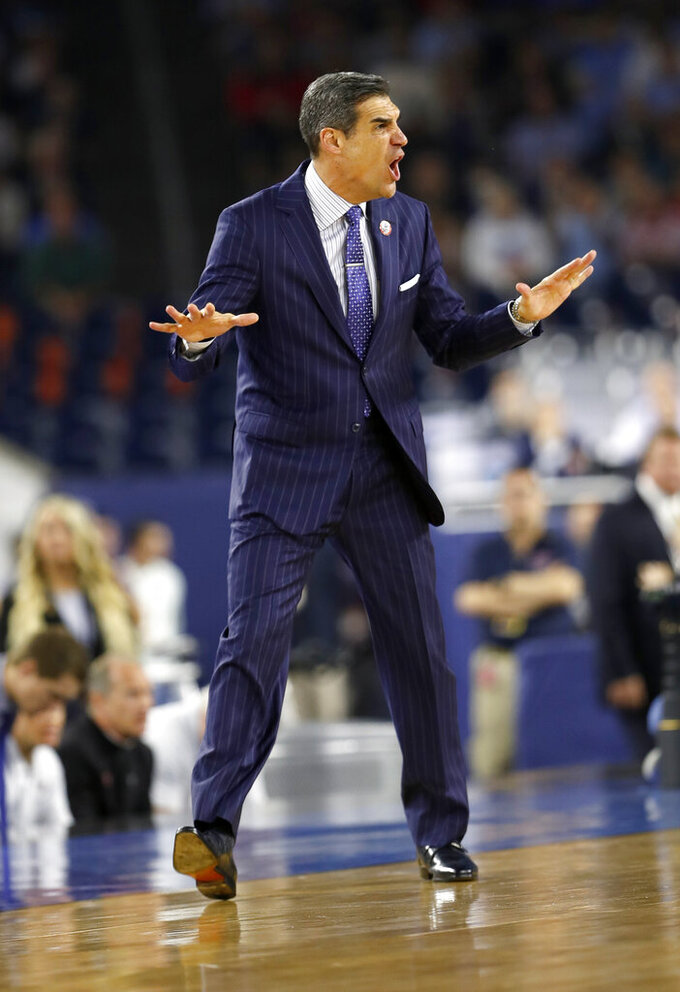 FILE - In this April 4, 2016, file photo, Villanova head coach Jay Wright directs his team during the first half of the NCAA Final Four tournament college basketball championship game against North Carolina, in Houston. (AP Photo/David J. Phillip, File)