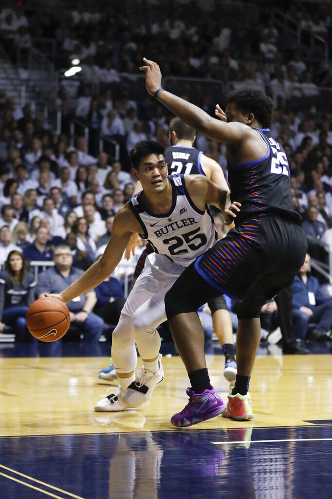 Butler's Christian David (25) goes to the basket against DePaul's Femi Olujobi (25) during the first half of an NCAA college basketball game, Saturday, Feb. 16, 2019, in Indianapolis. (AP Photo/Darron Cummings)