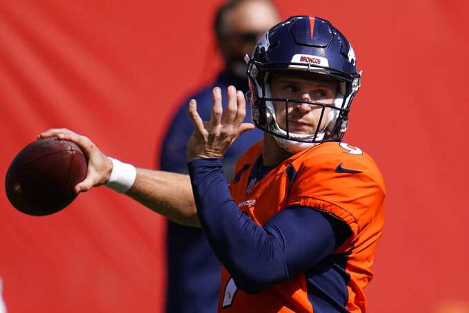 Denver Broncos quarterback Jeff Driskel warms up before an NFL football game against the Tampa Bay Buccaneers, Sunday, Sept. 27, 2020, in Denver. (AP Photo/Jack Dempsey)