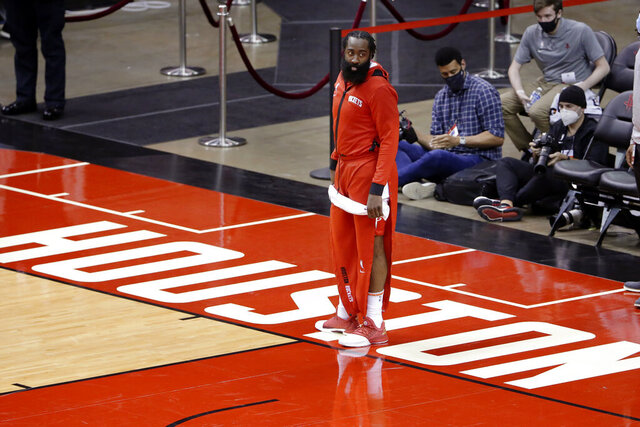 Houston Rockets guard James Harden leaves the court after their win against the San Antonio Spurs after an NBA basketball game Tuesday, Dec. 15, 2020, in Houston. (AP Photo/Michael Wyke)