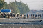 Security forces try to disperse anti-government protesters during clashes in central Baghdad, Iraq, Monday, Jan. 20, 2020. Iraqi security forces also used live rounds, wounding over a dozen protesters, medical and security officials said, in continuing violence as anti-government demonstrators make a push to revive their movement in Baghdad and the southern provinces. (AP Photo/Khalid Mohammed)