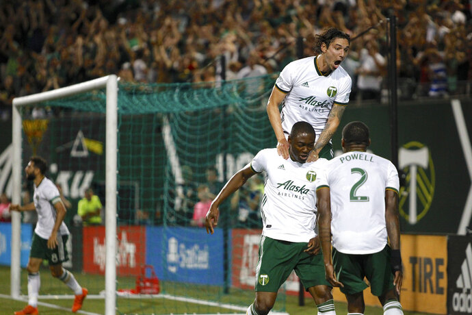 FILE - In this July 28, 2018, file photo, Portland Timbers' Fanendo Adi, second from right, celebrates with teammates after scoring a goal in the second half goal of an MLS soccer game against the Houston Dynamo in Portland, Ore. A fifteen-match unbeaten streak has moved the Timbers into second place in the Western Conference behind FC Dallas. (Sean Meagher/The Oregonian via AP, File)