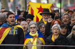 Supporter of Catalan regional president Quim Torra, gather outside Catalonia's high court in Barcelona, Spain, Monday, Nov.18, 2019. The pro-independence regional president of Catalonia is standing trial for allegedly disobeying Spain's electoral board by not removing pro-secession symbols from public buildings during an election campaign. Banner in Catalan reads