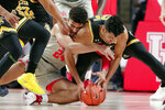 Houston guard Quentin Grimes (24) and Wichita State center Jaime Echenique (21) battle for the ball during the first half of an NCAA college basketball game Sunday, Feb. 9, 2020, in Houston. (AP Photo/Michael Wyke)