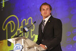 Pittsburgh quarterback Kenny Pickett listens to a question during an NCAA college football news conference at the Atlantic Coast Conference media days in Charlotte, N.C., Wednesday, July 21, 2021. (AP Photo/Nell Redmond)