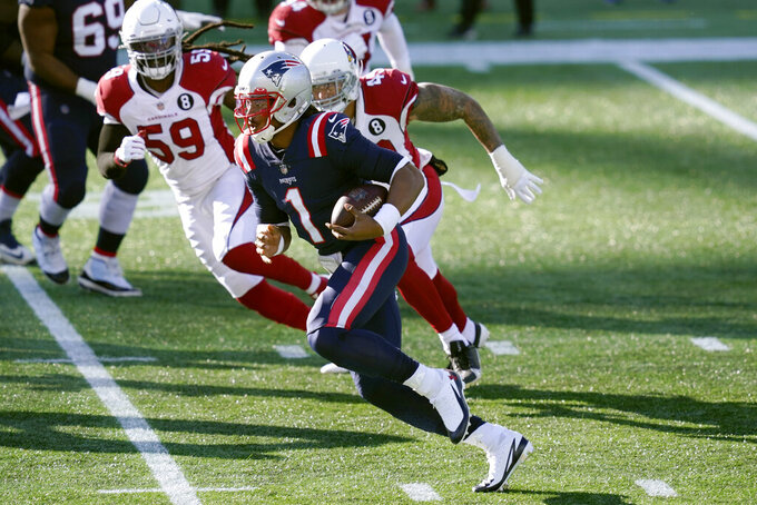 New England Patriots quarterback Cam Newton, front, scrambles away from Arizona Cardinals linebackers De'Vondre Campbell, left, and Kylie Fitts in the first half of an NFL football game, Sunday, Nov. 29, 2020, in Foxborough, Mass. (AP Photo/Elise Amendola)