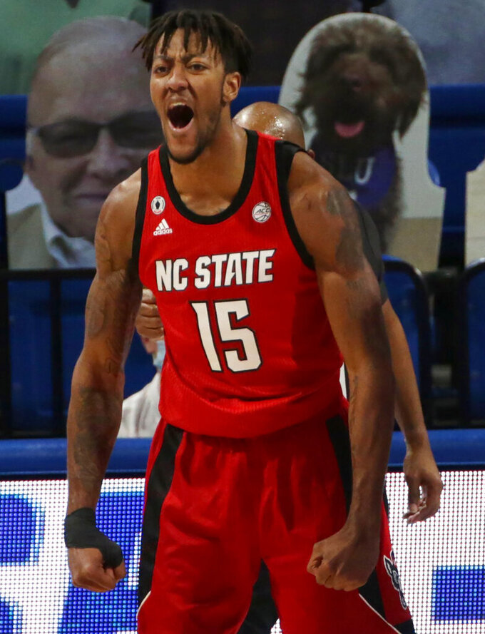 North Carolina State forward Manny Bates (15) reacts after being fouled after making a shot for a chance to make a 3-point play during the first half of an NCAA college basketball game against St. Louis, Thursday, Dec. 17, 2020, in St. Louis. (Laurie Skrivan/St. Louis Post-Dispatch via AP)