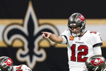 Tampa Bay Buccaneers quarterback Tom Brady (12) signals at the line of scrimmage against the New Orleans Saints during the first half of an NFL divisional round playoff football game, Sunday, Jan. 17, 2021, in New Orleans. (AP Photo/Brynn Anderson)