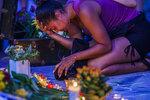Courtney Amborst grieves for her friend Deona M. Knajdek, late Monday, June 14, 2021, in Minneapolis. Knajdek was killed a day earlier when a vehicle drove into demonstrators. (Richard Tsong-Taatarii/Star Tribune via AP)