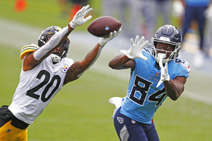 Pittsburgh Steelers cornerback Cameron Sutton (20) breaks up a pass intended for Tennessee Titans wide receiver Corey Davis (84) in the first half of an NFL football game Sunday, Oct. 25, 2020, in Nashville, Tenn. (AP Photo/Wade Payne)