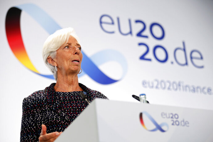 FILE - In this Sept. 11, 2020 file photo, European Central Bank (ECB) President Christine Lagarde attends a news conference during the Informal Meeting of Economics and Finance Ministers in Berlin, Germany.   The European Central Bank held off from strengthening its stimulus programs despite growing concern that a renewed surge in COVID-19 cases could stall the economy's recovery from the deep downturn early this year.  The bank on Thursday, Oct. 29,  made no change to its 1.35 trillion ($1.58 trillion) pandemic emergency bond purchase program, which pumps newly created money into the economy to keep credit flowing to businesses and promote economic activity.   Hannibal Hanschke/Pool Photo via AP, File)
