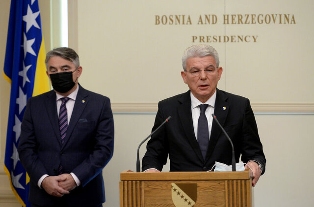 Croat member of the tripartite Presidency of Bosnia Zeljko Komsic, left, listens as Muslim member Sefik Dzaferovic make a statement after refusing to meet with Russian Foreign Minister Sergey Lavrov in the capital Sarajevo, Bosnia, Tuesday, Dec. 15, 2020. Bosnia's Muslim and Croat representatives in the country's three-member presidency have boycotted a meeting with Russian Foreign Minister Sergey Lavrov in a major snub to Moscow's top diplomat. On his second day of the two-day visit to Bosnia on Tuesday, Lavrov was due to hold talks with all three presidency members, including Sefik Dzaferovic, a Muslim, and Zeljko Komsic, a Croat, but only the Serb member, Milorad Dodik. attended the meeting. (AP Photo/Kemal Softic)