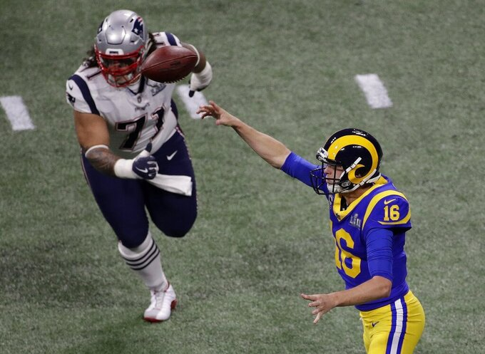 Los Angeles Rams' Jared Goff (16) throws the ball under pressure from New England Patriots' Danny Shelton (71) during the first half of the NFL Super Bowl 53 football game Sunday, Feb. 3, 2019, in Atlanta. (AP Photo/Charlie Riedel)