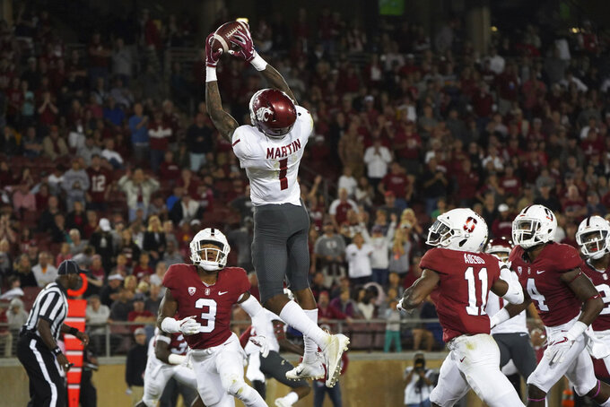 Washington State wide receiver Davontavean Martin (1) scores a touchdown in the second half against Stanford during an NCAA college football game on Saturday, Oct. 27, 2018, in Stanford, Calif. (AP Photo/Don Feria)