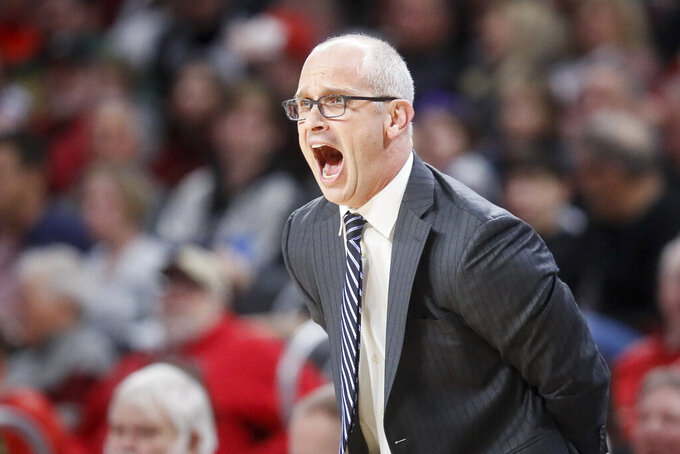 Connecticut head coach Dan Hurley directs his players from the bench in the first half of an NCAA college basketball game against Cincinnati, Saturday, Jan. 12, 2019, in Cincinnati. (AP Photo/John Minchillo)