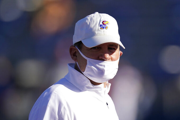 Kansas head coach Les Miles watches his team warm up before an NCAA college football game against Iowa State in Lawrence, Kan., Saturday, Oct. 31, 2020. (AP Photo/Orlin Wagner)