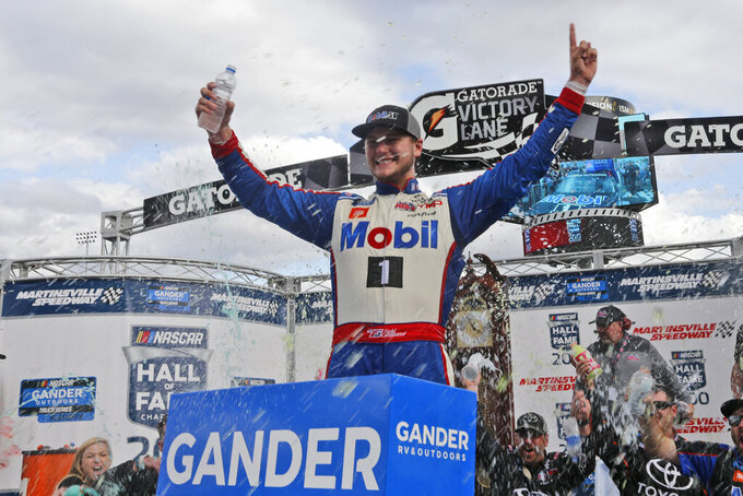 Todd Gilliland (4) celebrates winning the NASCAR Truck Series race at Martinsville Speedway in Martinsville, Va., Saturday, Oct. 26, 2019, (AP Photo/Steve Helber)
