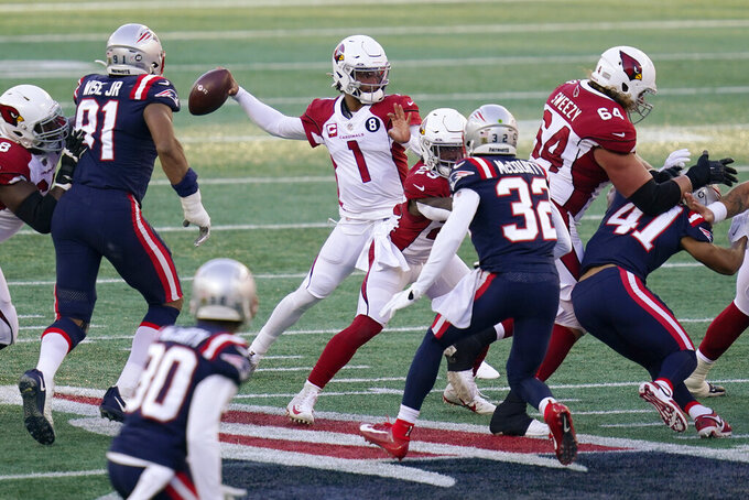 Arizona Cardinals quarterback Kyler Murray (1) passes under pressure from the New England Patriots in the first half of an NFL football game, Sunday, Nov. 29, 2020, in Foxborough, Mass. (AP Photo/Charles Krupa)