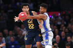 A pass-attempt by California forward Andre Kelly (22) is interrupted by Duke forward Javin DeLaurier, right, during the first half of the first round of the 2K Empire Classic NCAA college basketball tournament, Thursday, Nov. 21, 2019, in New York. (AP Photo/Kathy Willens)