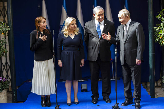 CAPTION CORRECTION:CORRECTS MOTHER'S NAME: Yaffa Issachar, left, mother of Naama, who is imprisoned in Russia on drug possession charges, meets Russian President Vladimir Putin, right, accompanied by Israeli Prime Minister Benjamin Netanyahu and his wife Sarah in Jerusalem on January 23,2020 . Putin, will be a guest of honor Thursday at a ceremony at the Yad Vashem Holocaust Museum marking the 75th anniversary of the Soviet Red Army's liberation of the Nazi Auschwitz death camp. (Heidi Levine, Pool via AP)