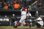 Boston Red Sox's Mookie Betts follows through on a solo home run against the Baltimore Orioles during the third inning of a baseball game Wednesday, May 8, 2019, in Baltimore. (AP Photo/Gail Burton)