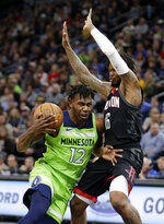 Minnesota Timberwolves guard Trevion Graham (12) drives on Houston Rockets guard Ben McLemore (16) in the first quarter during an NBA basketball game Saturday, Nov. 16, 2019 in Minneapolis. (AP Photo/Andy Clayton- King)