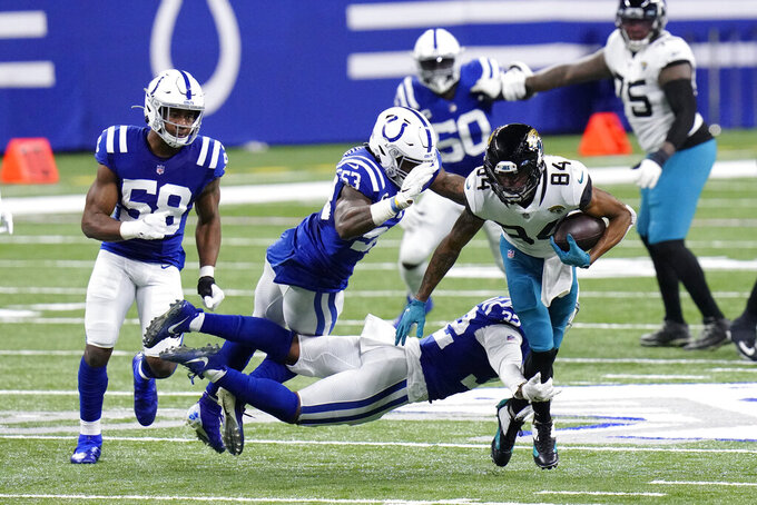 Jacksonville Jaguars' Keelan Cole Sr. is tackled by Indianapolis Colts' Julian Blackmon (32) during the first half of an NFL football game, Sunday, Jan. 3, 2021, in Indianapolis. (AP Photo/AJ Mast)
