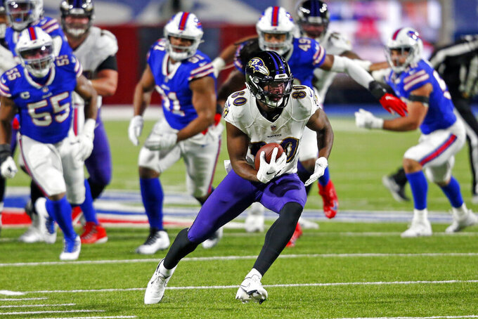 Baltimore Ravens wide receiver Miles Boykin (80) runs after making a catch during the first half of an NFL divisional round football game against the Buffalo Bills Saturday, Jan. 16, 2021, in Orchard Park, N.Y. (AP Photo/Jeffrey T. Barnes)