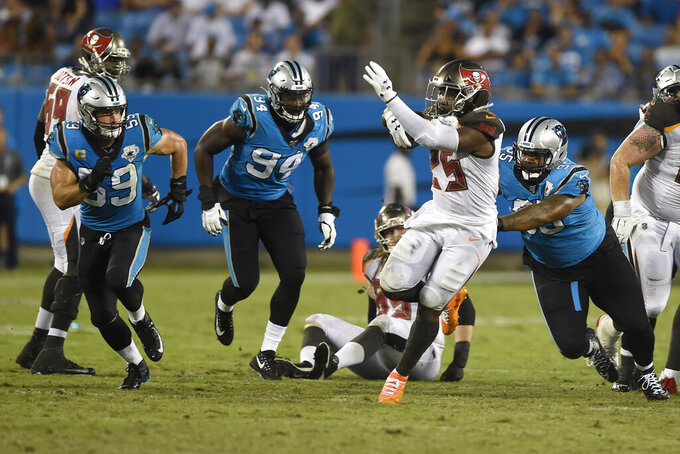Tampa Bay Buccaneers running back Peyton Barber (25) finds some running room against the Carolina Panthers during the second half of an NFL football game in Charlotte, N.C., Thursday, Sept. 12, 2019. (AP Photo/Mike McCarn)