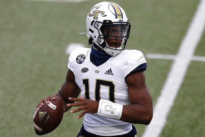Georgia Tech quarterback Jeff Sims (10) looks to pass during the first half of an NCAA college football game against Boston College, Saturday, Oct. 24, 2020, in Boston. (AP Photo/Michael Dwyer)