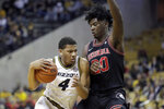 Missouri's Javon Pickett (4) heads to the basket past Georgia's Rayshaun Hammonds (20) during the second half of an NCAA college basketball game Tuesday, Jan. 28, 2020, in Columbia, Mo. Missouri won 72-69. (AP Photo/Jeff Roberson)