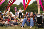 Festival goers at the 'Mind, Body & Zen' area at the Latitude festival in Henham Park, in Southwold, England, Friday July 23, 2021. (Jacob King/PA via AP)